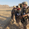 US Marine Female Engagement Team members wait for the signal to begin their patrol in the Helmand Province of Afghanistan in 2009. Photo credit: Julie Jacobson/AP
